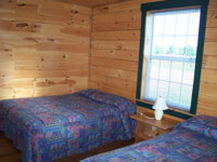 Log Cabin Rental Photos - Living Room Looking Toward One Bedroom and the Stairs - North Country Rivers